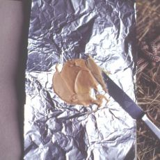 Making peanut butter bait with aluminum foil, Alan Eaton